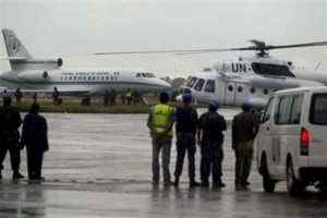 Taylor arrives at RIA from Nigeria and is boarding the helicopter for Sierra Leone
